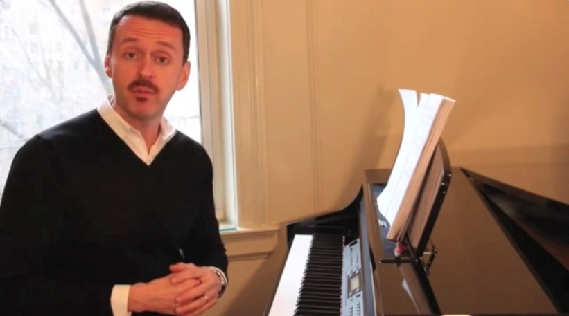 Andrew Lippa wearing black sweater at the piano playing big fish